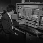Photo of man sitting in front of Nellie computer